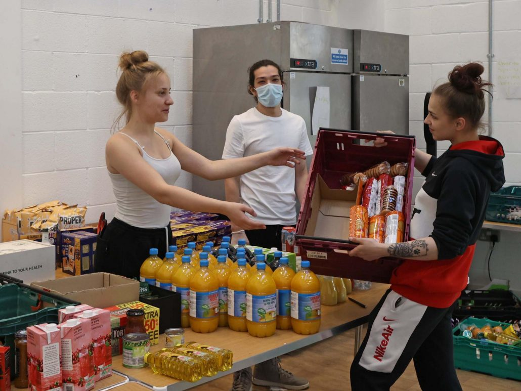 Help the Hungry: Teenage volunteers pitch in to sort goods for some of London's poorest families